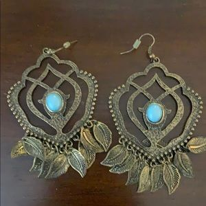 Cute earrings with turquoise in middle